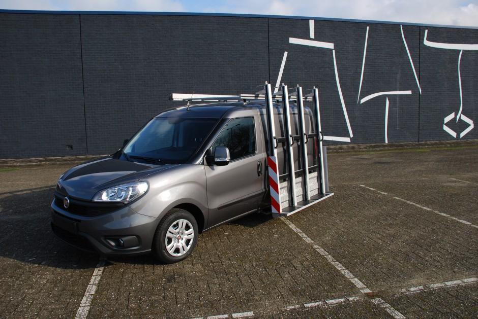 Kleine bestelwagen glasresteel roofpacker